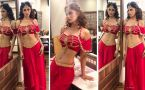 Mouni Roy looks sizzling in her Red dress & we are loving it!