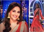 Madhuri Dixit Dazzles In Red Lehenga Saree