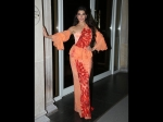 Of Subtle Orange And Fiery Red, Jacqueline's Gown Has A Sari Touch