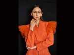 Rakul Preet Singh Sizzles In A  Bright Orange Frilly Crop Top Blazer And High Rise Pencil Pants