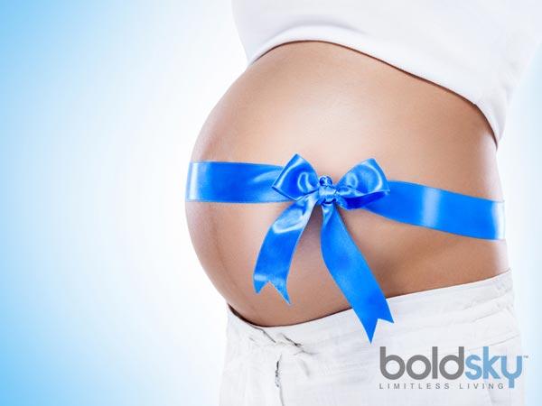 Фото живот беременной с бантиком