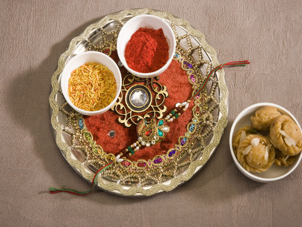 Rituals of raksha bandhan for Aarti thali decoration with rice