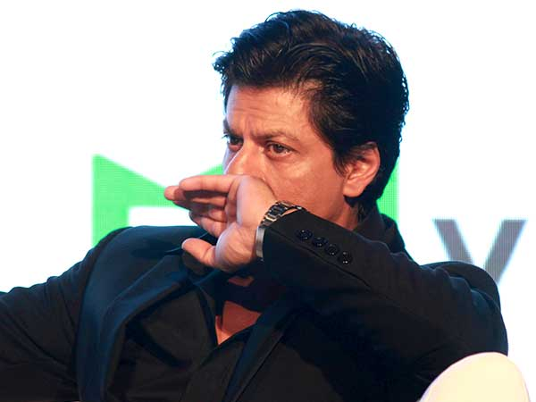 SRK in black blazer