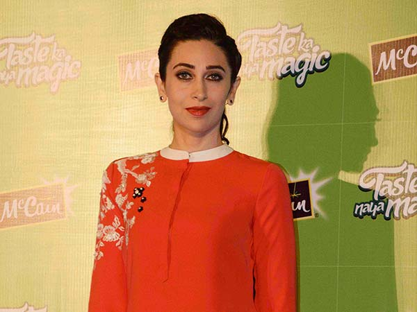 Karishma Kapoor wearing orange suit