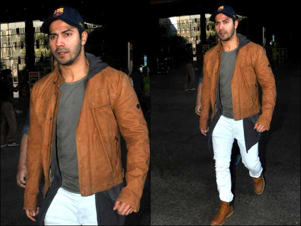 Varun Dhawan in tan jacket