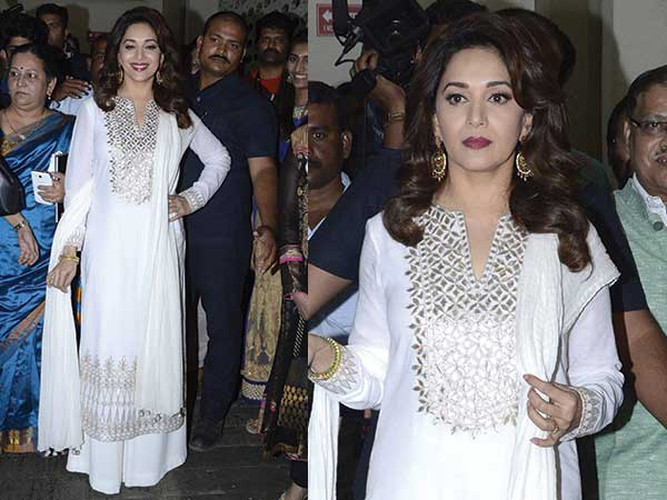 In Anita Dongre white suit