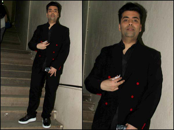 Karan wearing a black suit