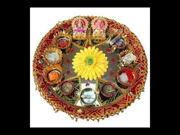 The legend associated with the varamahalakshmi vrata for Aarti thali decoration with grains