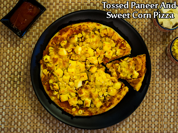 Tossed Paneer And Sweet Corn Pizza Recipe: How To Prepare Tossed Paneer And Sweet Corn Pizza At Home
