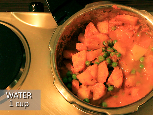 STEP BY STEP – HOW TO MAKE ALOO MUTTER GRAVY 1. Add a tablespoon of oil in a heated pan. 2. Add the chopped onions. 3. Sauté well until it turns to golden brown in colour. 4. Add the cut tomatoes and sauté continuously for a minute to avoid it from burning. 5. Add the grated ginger and 4 garlic cloves. 6. Add the chopped green chillies and sauté well for a minute. 7. It is done once the skin of the tomatoes starts to peel off. 8. Allow it to cool for 10 minutes. 9. Meanwhile, take 3 washed potatoes and peel the skin off. 10. Further, cut it into cubes. Keep it aside. 11. Add the sautéed mixture in a mixer jar. 12. Grind it into a smooth paste. Keep it aside. 13. Now, add 2½ tablespoons of oil in a heated pressure cooker. 14. Add jeera and allow it to splutter. 15. Add the cut potatoes and stir well. Let it cook for a minute. 16. Add the ground paste and mix it well. 17. Then, add salt and turmeric powder. 18. Add red chilli powder and dhaniya powder to spice up the dish. Mix well. 19. Add the green peas and mix it again. 20. Further, add a cup of water. 21. Close the lid and pressure cook it for upto 3 whistles. 22. Once done, take it off the stove and allow the pressure to settle. 23. Now, open the lid and add garam masala and jeera powder to it. 24. Finally, garnish it with coriander leaves. 25. Serve hot.