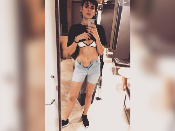 mandana karimi trolled for sharing buttonless pic