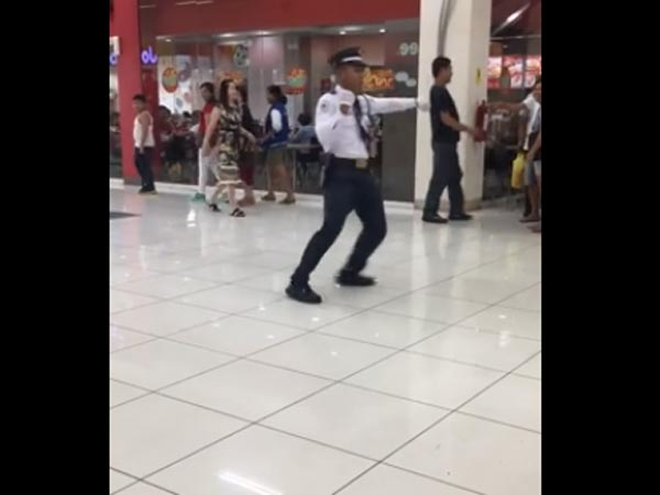 security guard starts dancing in a mall