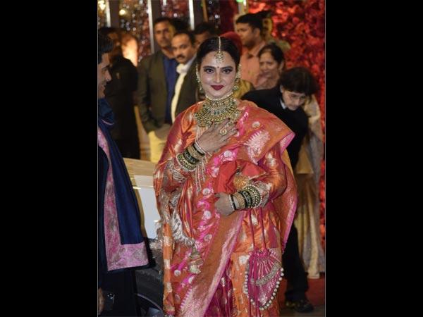 Rekha Looks Radiant As She Makes A Colourful Entry At Isha Ambani's Wedding