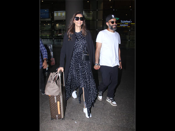 Sonam Kapoor Ahuja Keeps It Stylish With A Long Asymmetrical Dress At The Airport