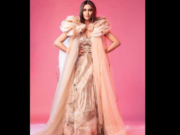 Krystle DSouza in a dramatic gown