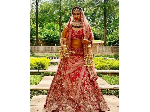Lisa Ray In A Pink Bridal Lehenga