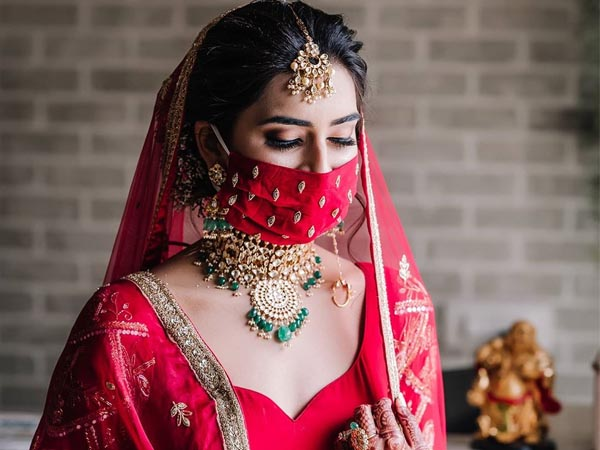 This Bride Looks Gorgeous In Her Red Lehenga But Creates Trend With Her Complementing Mask