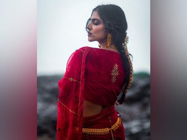 Malavika Mohanan In A Red Bridal Saree