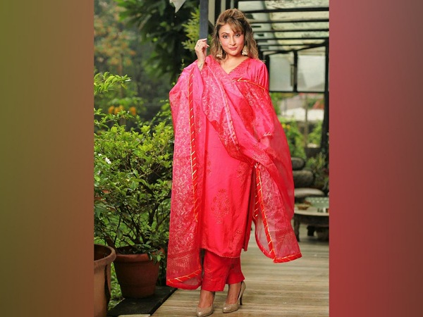 Urvashi Dholakia In A Bright Red Suit