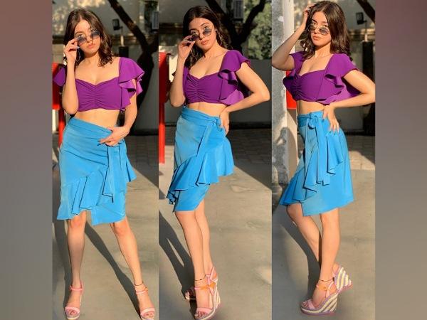 Divya Khosla Kumar In Purple Top And Blue Skirt