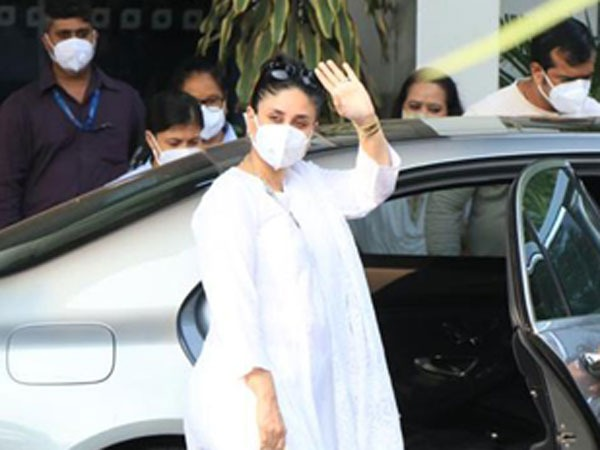 Kareena Kapoor Khan's Latest Airport Look Features A White Suit, Silver Jewellery, And KKK Bag