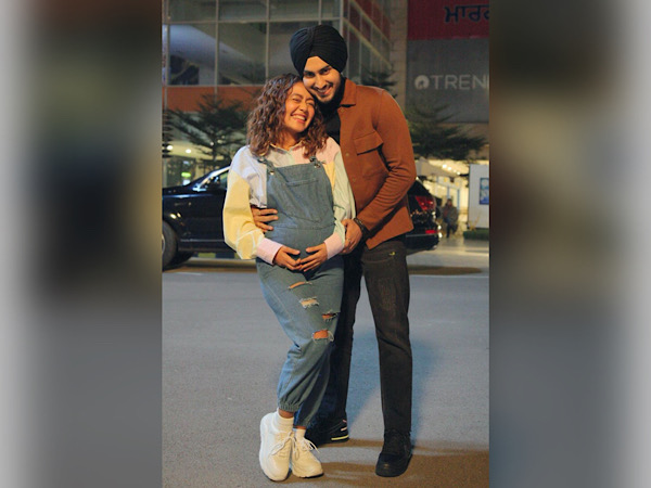 Neha Kakkar Flaunts Baby Bump In Denim