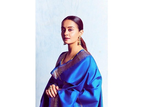 Surveen Chawla Keeps It Simple And Elegant For A Wedding Function And We Love It