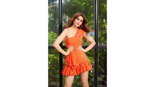 Kriti Sanon Looks Fresh And Radiant In Her Vibrant Orange Dress; Take A Look At Her Orange Eye Shadow Too!
