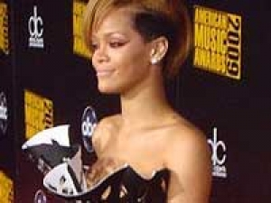Rihanna Britney Spears Attraction 140411 Aid