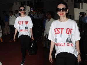 Karisma Kapoor Flaunts Her Cool And Sassy Side By Pairing An Oversized Tee With Denims