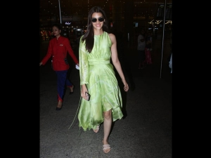 Kriti Sanon Spotted In A Green Dress At The Airport