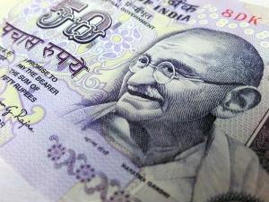 Reasons Behind Mahatma Gandhi Photo On Indian Currency
