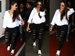 Malaika Arora Khan Fashion Dressed In Stylish Travel Outfit