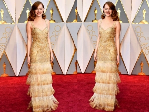 Emma Stone Wearing Givenchy Gold Gown At Oscars