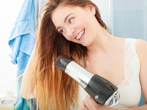 The Right Way To Blow Dry Your Hair