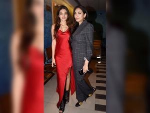Nidhhi Agerwal And Kriti Sanon Wearing Satin Outfits At Padman Screening