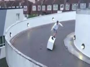 Man Surfs Fridge Around Multistorey Car Park