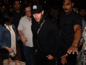 Nick Jonas All Black Look Leaves Usa With Parents
