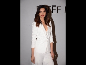 Diana Penty In An All White Pantsuit For The Est E Lauder Event