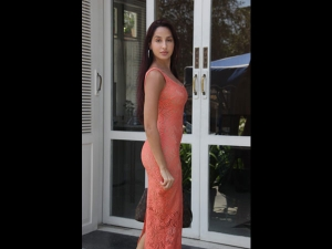 Nora Fatehi Spotted In A Peach Bodycon Long Dress