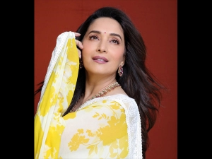 Madhuri Dixit Nene In A Yellow Sari At A Reality Show