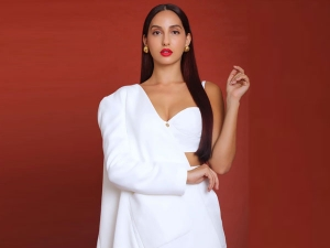 Nora Fatehi In A White Pantsuit For Batla House Promotions