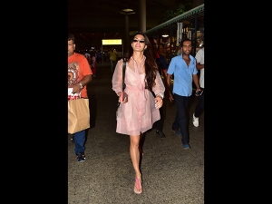 Jacqueline Fernandez Spotted At The Airport In A Pink Dress
