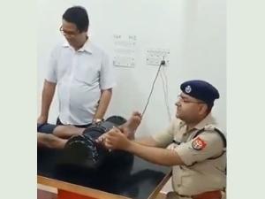 Watch Up Cop Ajay Kumar Giving A Foot Massages To A Kanwariya