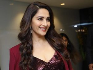 Madhuri Dixit Looks Glamourous In A Dress At Iifa Awards Press Event