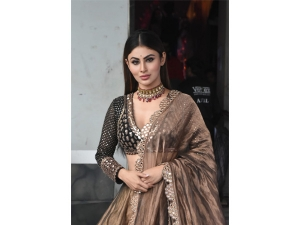Naagin Actress Mouni Roy In A Brown Lehenga For Made In China Promotions At Did