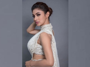 Naagin Actress Mouni Roy In A White Belted Sari For Made In China Trailer Launch