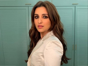 Parineeti Chopra S Photoshoot In A White Pantsuit