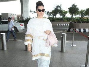 Kangana Ranaut S Cat Eyed Frame And Suit Airport Look