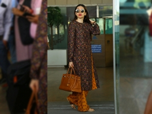 Karisma Kapoor Spotted At The Airport In A Suit